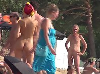 Nu1380# Nude beach voyeur cam takes a shots on a nudist beach. Beautiful nude body on the backgrou