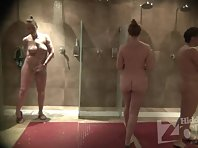 Sh1927# Again the shower room is filled with women and girls. A tall, long-legged beauty stands out