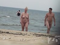 Nu2027# Many nudists come to the beach with couples. Some men are excited by the fact that others se