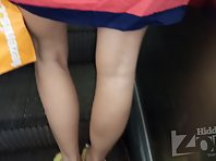 Up2861# Under the skirt of a girl in a short multi-colored dress. The girl stood with her legs wide