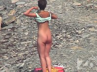 Nu1441# On the beach a new character - skinned blonde. She took off and we can all appreciate her