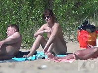 Nu1683# Nude beach voyeur cam turned attention to the cheerful company of young boys and girls. Th