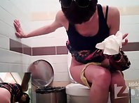 Wc1827# Skinny girl in green shorts. Quickly lifted her skirt and pee. Great shots the girls toile