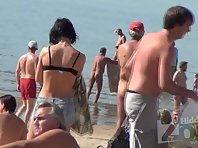 Nu1730# Slim brunette undressing and going to sunbathe slowly. Excellent footage nude beach voyeur