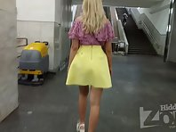Up2669# A slender blonde in a short yellow skirt. Another good model for shooting upskirt in the sub