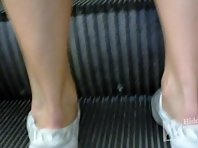 Up1986# Tanned girl in a short white dress. Our cameraman shot with a hidden camera her hairy crot