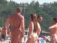 Nu1378# Nude beach voyeur cam lens on a young girl and her two friends. They playfully looking at