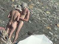 Nu1504# Gradually the shore filled nudists. They did not hesitate and go absolutely naked. Nude be