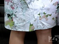 Up2459# Upskirt girl in a short blue skirt. In the objective of our spy camera came her shaved crotc