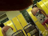 Lo1315# Women wiped off after a shower in the locker room. Young tanned babe walks by our operator