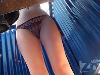 Bc1796# Young girl in a brown swimsuit. She slowly took off her swimsuit and changed. Another exce