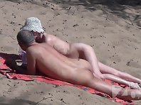 Nu1850# In the middle of a sunny summer day on a nudist beach a lot of people. Our hidden camera swi