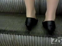 Up1761# A girl in a short black coat. Nice ass in torn pantyhose and black panties. While I was go