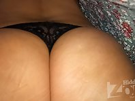 Up2959# Under the skirt of a tanned brunette in a short multi-colored dress. Gorgeous ass and shaved
