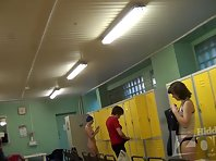 Lo1229# A young girl undresses and puts on a swimming cap. We admire her beautiful tits elastic. E