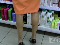 Up2683# Upskirt in the store. The girl in the orange skirt. Our operator has been preparing for a lo