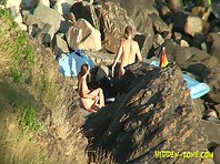 Nu1228# Naked man and woman sitting on the beach and admire the sea waves. Perhaps they already ha