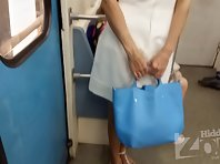 Up2810# Under the skirt of a slender girl in a short white dress. Our operator several times put his