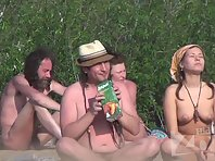 Nu1351# Nude beach voyeur camera turned her attention to a couple, like a hippie. The girl has a b