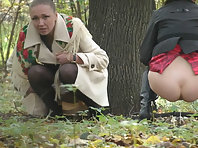 Voyeur girls peeing outdoors.