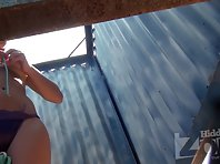 Bc1746# Girl with big boobs. Look at her balls is a pleasure. Beach cabin voyeur cam tries not to
