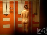 Sh1216# Red-haired girl taking a shower after a workout. She turns in the hot water jets, showing