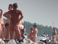 Nu1379# A typical day on a nudist beach - naked people walking around, sneak see each other. Women