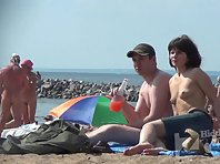 Nu1328# Next to the operator of our nude beach voyeur cam young couple sunbathing. They treat othe