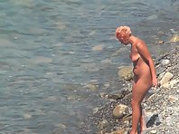 Nu1463# Girls with their boyfriends come to the nudist beach. Guys do not hesitate view their girl