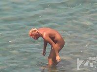 Nu1474# On a beautiful summer day nudists come to sunbathe and swim. Close hidden Nude beach voyeu