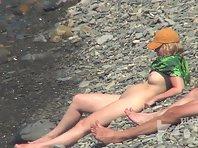 Nu1449# A few more girls get into the lens Nude beach voyeur cam. Good optics and bright sun helps