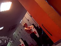 Lo1597# The slender blonde dressed after a workout. Our cameraman filmed in the locker room voyeur
