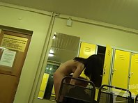 Lo1292# Tanned brunette undresses in front of the mirror to go to a tanning salon. Great stripteas