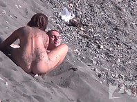 Nu1415# Girl decided to play with the sand in front of one of the guys. She twists her tits and hi