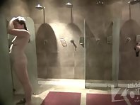 Sh1965# There are two women in the shower. One is young with white delicate skin, the other is older