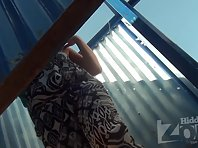 Bc1674# The girl in a red bathing suit. She stood with her back to our beach cabin voyeur camera.