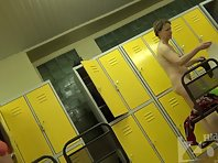 Lo1312# Girls and women dress up in the pool locker room. Young girl undressing and wrapped in a t