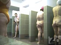 Sh2069# The women walk in and out of the shower, the camera watching them. At the end of the video,