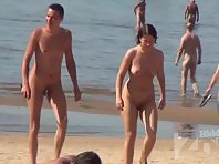 Nu2223# Nudists on the beach go about their business. Our camera monitors them and does not miss any