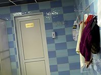 Lo1465# Hidden camera in the pool's locker room. Plump girl in black swimsuit shows her gorgeous b