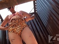 Bc2035# A pretty brunette dresses a swimsuit in a beach booth. Beautiful tanned body and hairy pussy