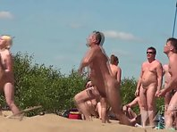 Nu1668# Around the players formed a group of fans. There's some nice naked women. Maybe they are s