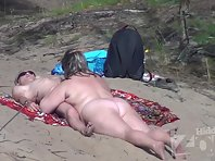 Nu1675# The woman starts to suck a man's penis. This is not often seen even on a nudist beach! How