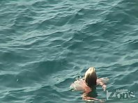 Nu1216# The blonde continues to swim in the sea, but soon comes up on the shore, and again, we see