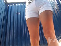 Bc1842# Girl in white shorts and undressing dress swimsuit. Our cameraman filmed close-up of her h