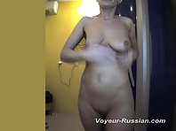Pv733# Tanned brunette naked smeared with cream before sunbathing. Our hidden camera captured close-