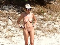 Nu1987# The naked girl walks along the shore of a small forest lake. She does not suspect that she i