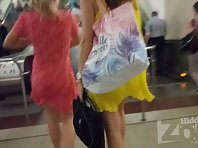 Up2872# Under the skirt of a slender girl in a short yellow dress. Her pubis in white panties and a