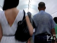 Up1987# Slender brunette in a short white dress. In the subway escalator can shoot great pictures