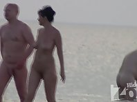 Nu1075# Another couple out of the water - a woman's big tits and a nice figure.